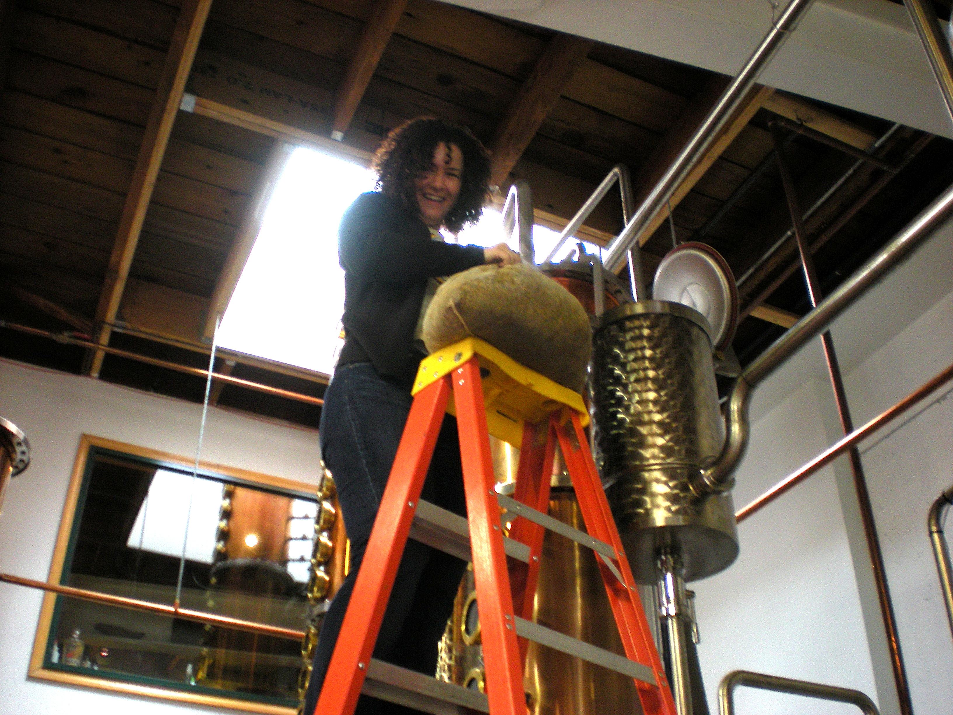 "Charlene removes the botanicals from ""BEV"" at Dry Fly Distillling."